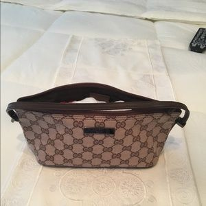 Gucci monogram pocketed cosmetic bag
